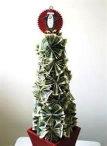 fold dollar into christmas tree how to make money on dollar bill origami money origami and dollar bills