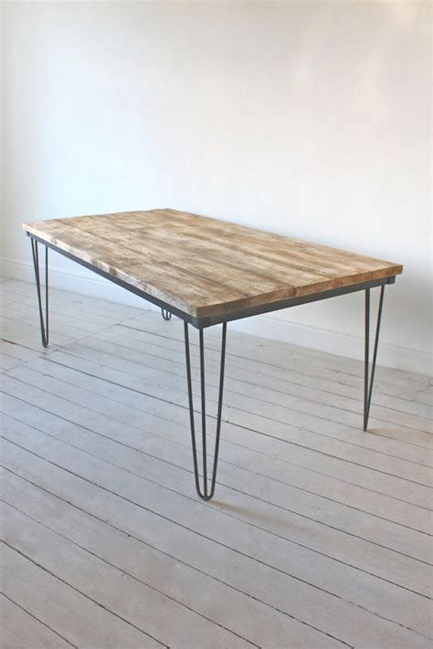 Reclaimed scaffolding board dining table with dark steel hairpin legs