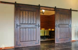 Barn Door Sliders Rustic Barn Door Hardware On Wine Tasting Room Mediterranean Wine Cellar Portland By