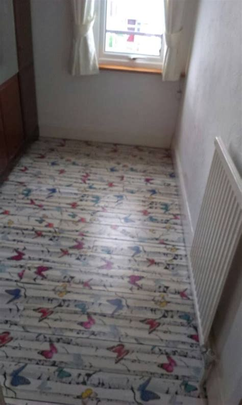 Decoupage floor, using wallpaper with backing removed