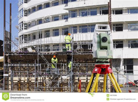 layout building using total station suveying measuring instrument inside plant stock photo
