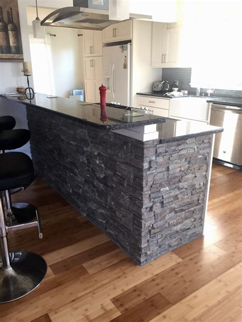 kitchen rock covering a brick fireplace diy project creative faux panels