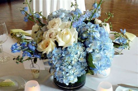 blue hydrangea centerpiece blue and gold floral arrangements blue wedding flowers centerpieces hydrangea