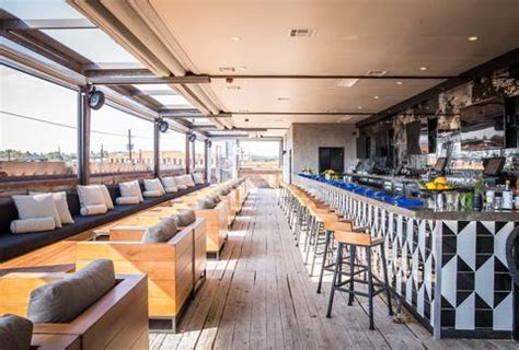 top bars in dallas best rooftop bars in dallas texas for drinking outside thrillist