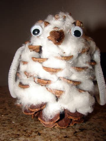 Tippytoe Crafts Pine Cone Snowy Owls - this is a craft snowy owl open ended for children