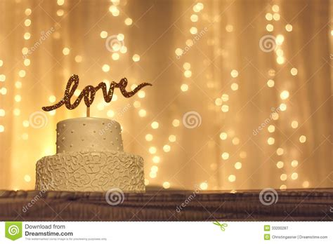 Awesome Christmas Lights Hooks #4: Wedding-cake-love-topper-simple-white-word-written-sparkling-gold-letters-top-white-twinkling-lights-33200287.jpg