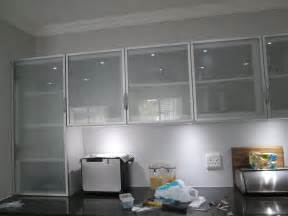 frosted glass cabinet door inserts this kitchen is incorporating aluminium frame cabinet