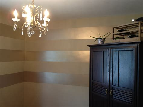 metallic paint in bathroom metallic striped wall for bathroom silver striped and gold fixtures chandelier ect