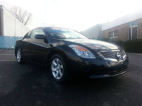 purchase   nissan altima coupe  salvage title