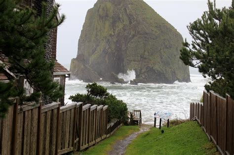 haystack rock cannon beach at high tide down by the sea