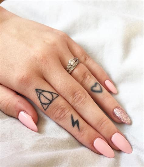heart tattoo on wedding finger meaning here for deathly hallows and hearts deathly hallows