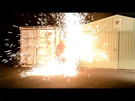 explosion of capacitor explosion from high voltage capacitor bank into steel wool gives a big shower of sparks