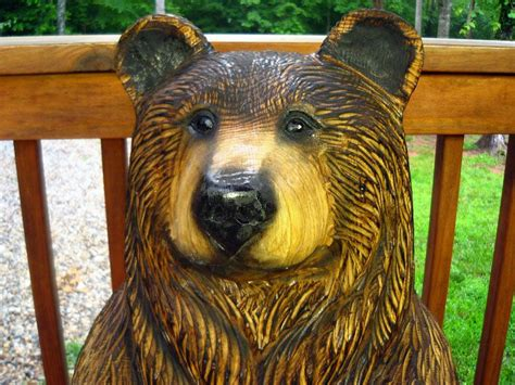 handmade brown bear chainsaw wood sculpture  sleepy