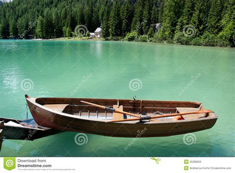 on a row boat row boat floating on the water stock photos image 25280603