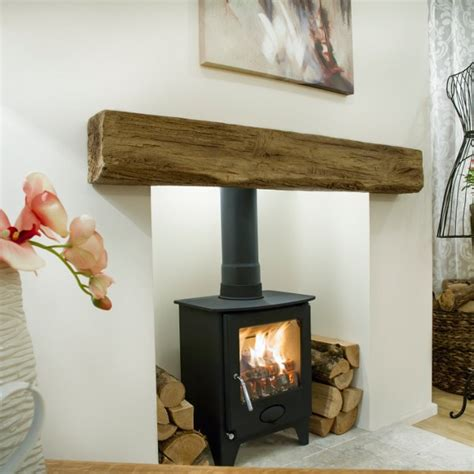 Wooden Beam Above Fireplace by Newman Clovelly Debrett Fires