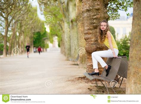 sitting on a park bench girl sitting on a bench in park royalty free stock photography image 31087807