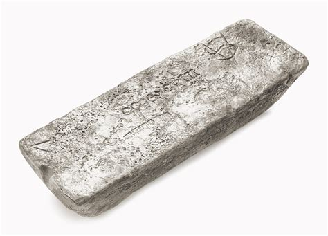 1 pound silver bar waddel examines a silver ingot from a shipwreck