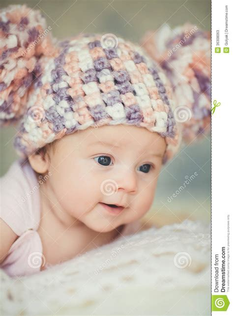 Sweater Baby Gambar Bordir newborn baby in knitted cap with bubonic stock