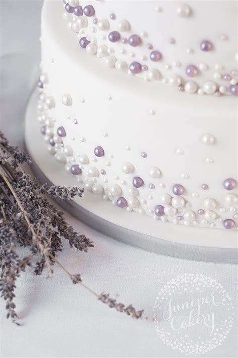 Ivory and lavender pearl embellished wedding cake by