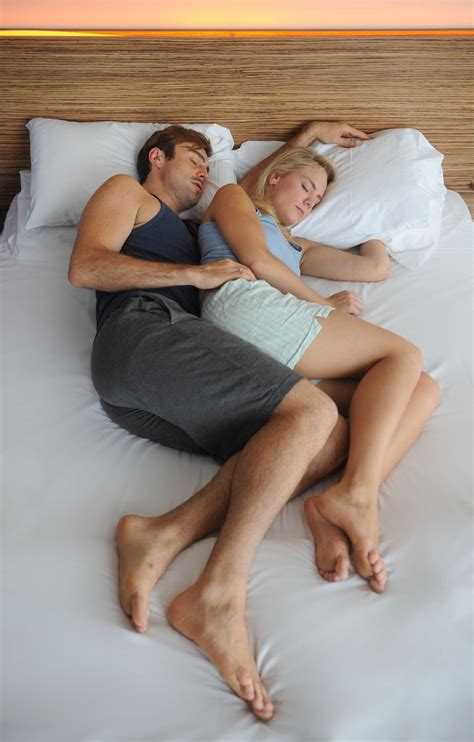 couples sleeping positions what does a couple s sleeping position say about their