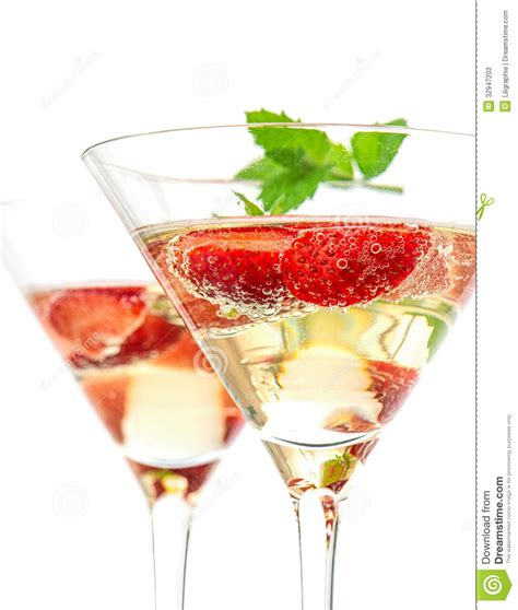 martini white strawberry cocktail with berry in martini glass stock