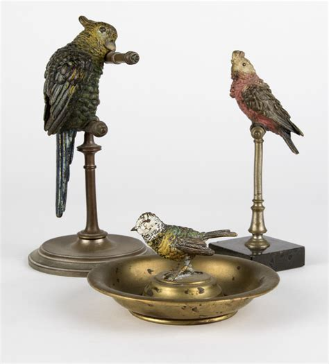 a of three vienna bronze vanity items
