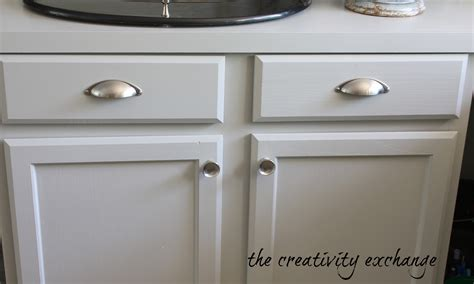 white kitchen cabinets with brushed nickel hardware
