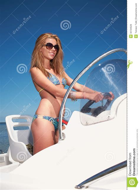 boat driving mask woman driving a motor boat royalty free stock images