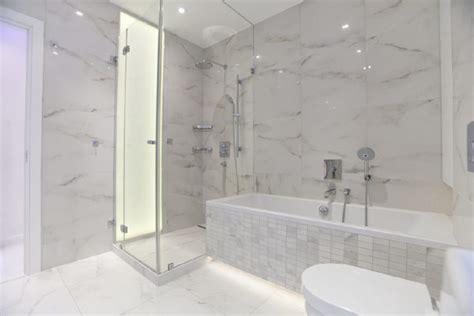 White And Gray Marble Bathrooms by Dizajn Doma Interijer Doma Namjestaj Arhitektura