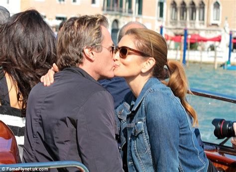 George Clooney Kisses For The Right Price by And Husband Rande Gerber Join George