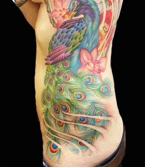 peacock back tattoo designs amazing peacock will offer you seductive look