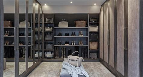 Shoe Closet With Doors Walk In Closet With Paneled Bi Fold Wardrobe Closet Doors Transitional Gray Walk In Closet With Mirrored Wardrobe Doors Contemporary Closet