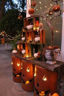 Fall Home Decorating Ideas nested crates and pottery pumpkins with led candles and string lights