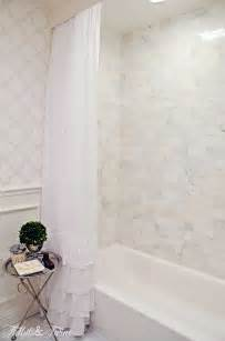 Guest bathroom remodel marble tile tub with ruffle shower curtain