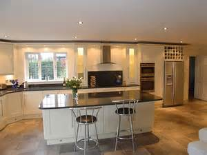 Shaker style kitchen in cream painted solid wood doors and nero impala