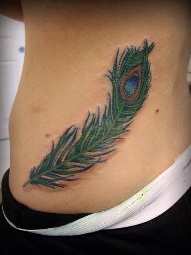 peacock feather tattoo hip awesome full color peacock feather female hip tattoo