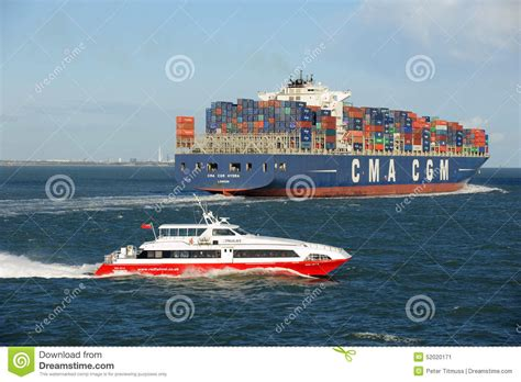 catamaran container ship container ship and a passenger catamaran passing the stern