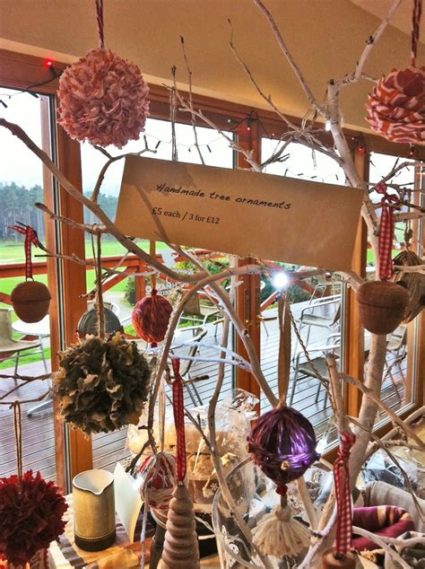 how to display christmas ornaments at fair branches with items like bows pins as tree ornaments displayed for the world to see