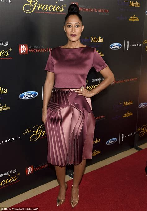 tracee ellis ross lipstick blackish maggie gyllenhaal stuns in a plunging black gown as she s