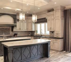 gray kitchen with white cabinets grey island with white countertop and antique white