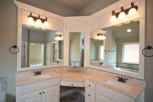 master bath with corner vanity and sinks