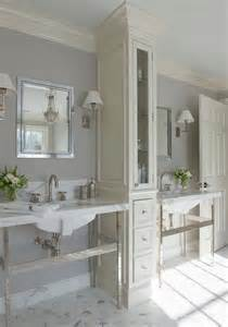 ivory and gray bathroom with linen cabinet between