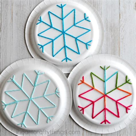 Things To Make Out Of Paper Plates - paper plate snowflake yarn i crafty things