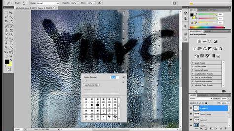 guida effetto scritta su vetro bagnato con photoshop