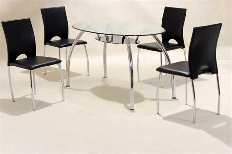 oval clear glass chrome dining table and 4 chairs