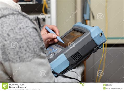 telecom technician adjusting reflectometer royalty free