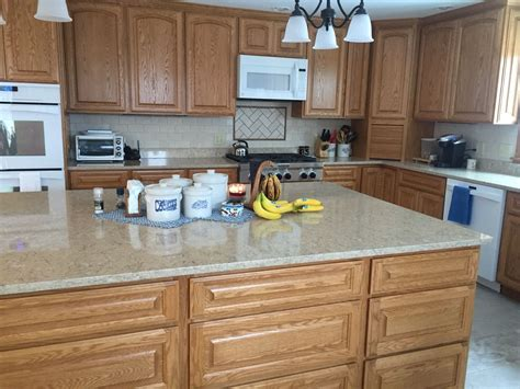 quartz countertops with light oak cabinets open kitchen with quartz counters and oak cabinets