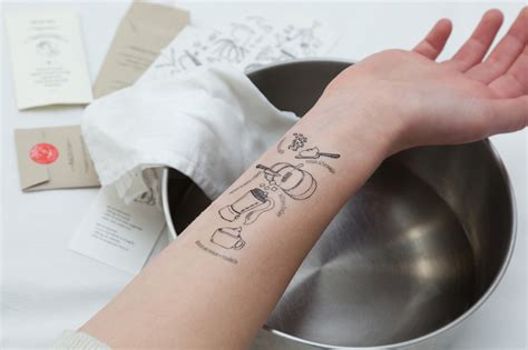 designboom tattoo i tradizionali tattoo recipes are applied onto arm for cooking