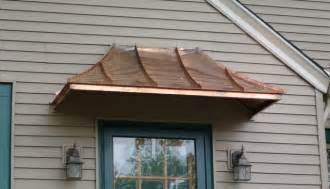 copper bow windows and door awnings