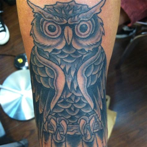 gold rush tattoo traditional owl done by bucky crispin gold